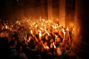 Christian Orthodox worshippers hold up candles lit from the 'Holy Fire' as thousands of Orthodox Christians gather in the Church of the Holy Sepulchre in Jerusalem's Old City on April 26, 2008 during the Orthodox Easter ceremony of the 'Holy Fire'. The ceremony celebrated in the same way for 11 centuries, is marked by the appearance of 'sacred fire' in the two cavities on either side of the Holy Sepulchre. The Holy Sepulchre in Jerusalem is the site of the final resting place of Jesus Christ, according to Christian tradition. AFP PHOTO/GALI TIBBON (Photo credit should read GALI TIBBON/AFP/Getty Images)